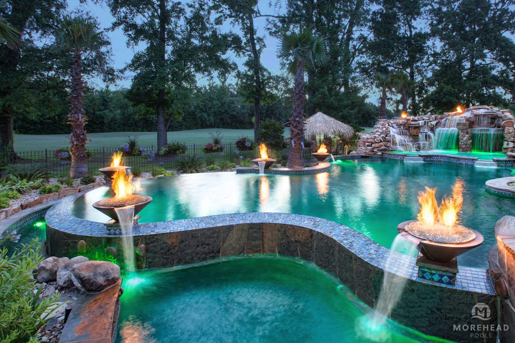 Luxury swimming pool with water features and fire features