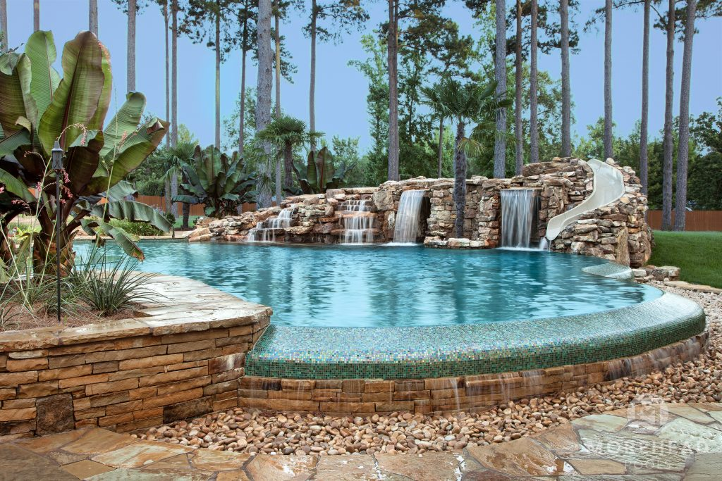 Infinity pool by Morehead Pools with water features