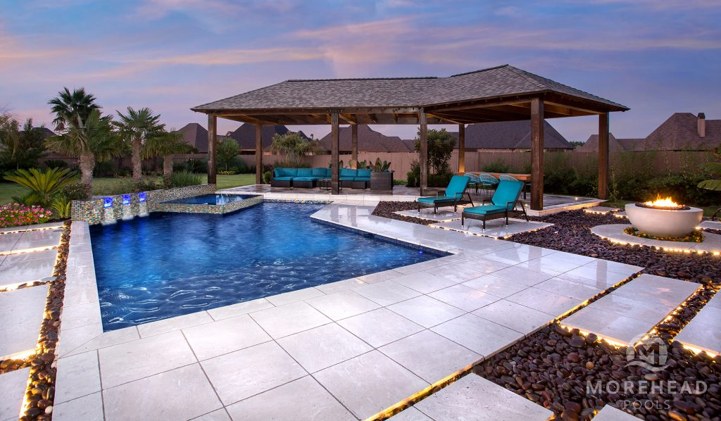 Luxury outdoor living space with pool, fire feature and cover